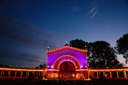 Spreckels Organ Pavilion in Balboa Park lit up for December Nights.
