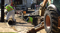 City crews work on a sinkhole that opened after a water main break on Shawnee...