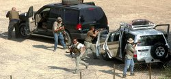 Private security contractors stage a drill in Baghdad, Iraq in 2004.