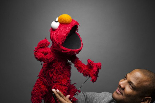 "Elmo with puppeteer Kevin Clash in teh documentary ""Being Elmo."""