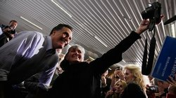 Republican presidential contender Mitt Romney campaigning in Ames, Iowa, on T...