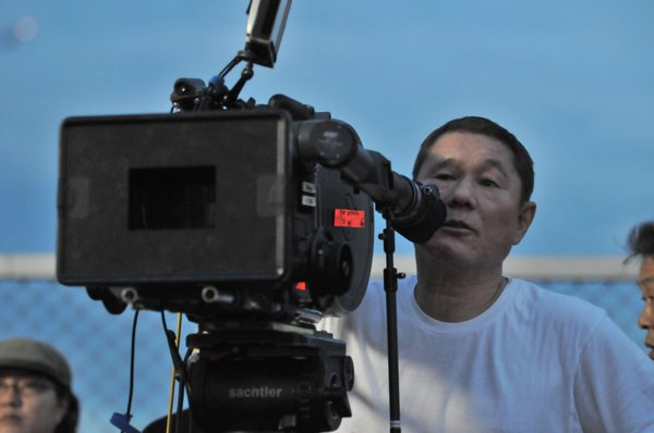 "Takashi Kitano (as he's called when behind the camera and Beat Takashi when he's in front) directing ""Outrage."""