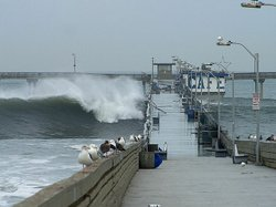 Large waves crash against the Ocean Beach Pier in 2002.