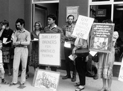 Anti-apartheid demonstrators protest Barclays Bank's involvement in South Africa. United Kingdom, 1980s.