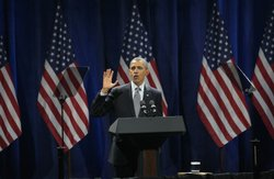 President Barack Obama speaks at a rally to help raise money for his re-elect...