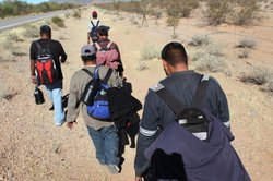 Undocumented Mexican immigrants walk through the Sonoran Desert after illegally crossing the U.S.-Mexico border border on January 19, 2011 into the Tohono O'odham Nation, Arizona.