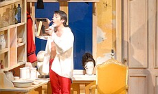 "Figaro shaving his face in ""The Barber Of Seville."""