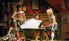 "Ernesto enjoys a bubbly bath surrounded by beautiful bar girls in ""Don Pasquale."""