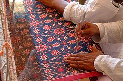 Textile artists demonstrate double ikat weaving at the 2002 Smithsonian Folklife Festival featuring The Silk Road.