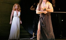 Performance photo of Salome (Lise Lindstrom) with a bound John the Baptist (Greer Grimsley).