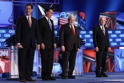 Republican presidential candidates (L-R) former U.S. Sen. Rick Santorum, former Massachusetts Gov. Mitt Romney, former Speaker of the House Newt Gingrich, and U.S. Rep. Ron Paul (R-TX) arrive on stage before a debate at the North Charleston Coliseum January 19, 2012 in Charleston, South Carolina.