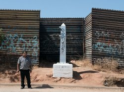As more fencing has been built along the U.S.-Mexico border, markers like this one delineating the boundary near Tecate have been left entirely on the Mexican side of the fence.