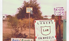 Signs welcome different clubs to Slab City.