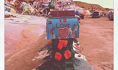 A mailbox is one of many objects that Leonard Knight painted at Salvation Mountain.
