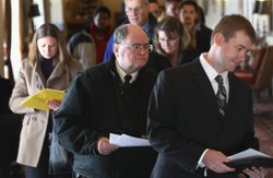Job applicants enter the 'Denver Hires Job Fair' on December 5, 2011 in Denve...