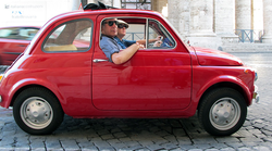Anthony Bourdain and a friend cruise the streets of Rome on an episode of