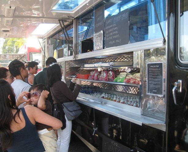 Food Truck Serving Up Food On Street corner
