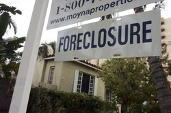 A foreclosure sign hangs in front of a home December 14, 2006 in Miami, Florida.