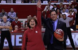 In a show of solidarity, Rabbi Sue Silberberg receives the game ball at India...
