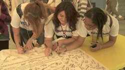At Lancaster High School in southern California, students sign a pledge to en...