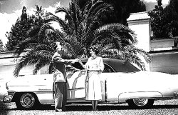 Earl Tupper, inventor of Tupperware, presents Brownie Wise, head of Tupperware Home Parties, with a pink Cadillac at the companys Florida headquarters. A self-taught saleswoman, Brownie built an empire out of bowls that burped.