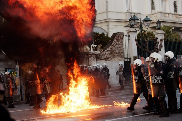 Demonstrators throw fire bombs to riot police during violent protests in central Athens February 12, 2012.