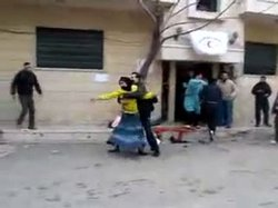Activists say this image, taken from a video uploaded to YouTube, shows Syria...