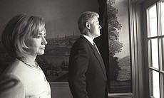 President Clinton and First Lady Hillary Rodham Clinton stand alone and look ...