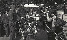 President Clinton talks to reporters and photographers on the South Grounds, ...