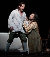 "Mariusz Kwiecien as the title character and Luca Pisaroni as Leporello in the Met's new production of Mozart's ""Don Giovanni."""