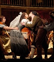 "Mojca Erdmann as Zerlina and Joshua Bloom as Masetto in the Met's new production of Mozart's ""Don Giovanni."""