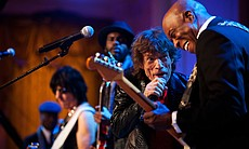 "Mick Jagger sings and Buddy Guy plays guitar as President Barack Obama and First Lady Michelle Obama host IN PERFORMANCE AT THE WHITE HOUSE ""Red, White and Blues"" in celebration of blues music in the East Room of the White House, Feb. 21, 2012. The concert is in recognition of Black History Month. In the background, from left, music director and band leader Booker T. Jones, Jeff Beck and Gary Clark Jr. joined in for the song."