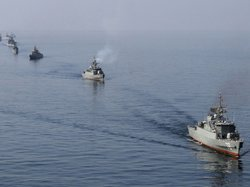 Iranian Navy boats take part in exercises in the Strait of Hormuz this past J...