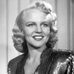 """Songbird Peggy Lee sings her 1943 hit """"Why Don't You Do Right"""" with the Benny..."""