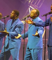 This historic reunion of classic recording artists of the decade includes the Blue Notes, appropriately attired.