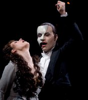 "Sierra Boggess as Christine and Ramin Karimloo as The Phantom in ""Phantom Of The Opera At Royal Albert Hall."""