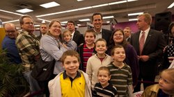 Rick Santorum poses with people at Harvest Graphics, a small business, during...