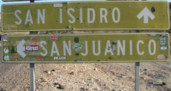 Surf themed stickers mark the road sign to San Juanico, which some say gets v...