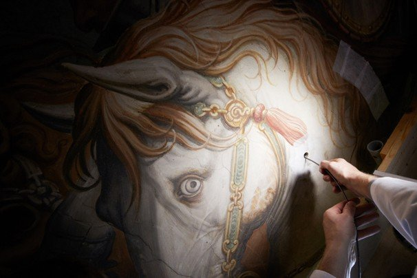 "This photo shows an endoscope being thread into the Vasari wall to find signs of the lost Leonardo painting ""The Battle of Anghiari"" in Florence's Palazzo Vecchio. (DAVE YODER/National Geographic - AFP/GETTY IMAGES)"