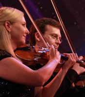 Close-up performance shot of musicians from Orchestra Nova.