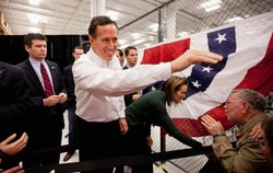 Former Pennsylvania Sen. Rick Santorum and his wife, Karen, greet supporters during a rally Saturday in Springfield, Mo.