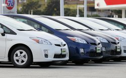 Brand new Toyota Prius hybrids sit on the sales lot at City Toyota on Novembe...