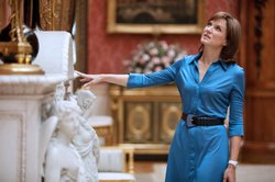 Host Fiona Bruce walks around the rooms and corridors of Buckingham Palace, c...