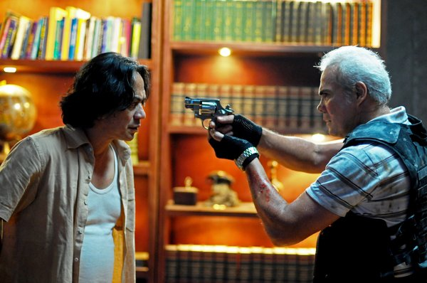 "Ray Sahetapy as Tama and Pierre Gruno as Wahyu in ""The Raid."""