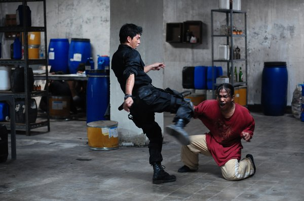 "Iko Uwais as Rama and Acip Sumardi as another gang member in ""The Raid."""