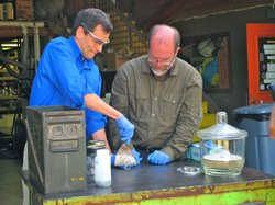 Salting popcorn the hard way: Theo Gray (right) and David Pogue (left) mix pure chlorine gas with explosive heated sodium. The result is table salt.