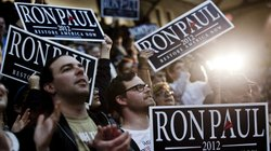 Supporters of Texas Rep. Ron Paul cheer as the Republican presidential candid...