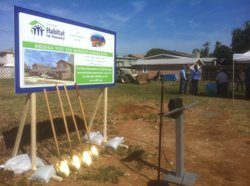 Shovels gleam in the sun as they await a groundbreaking for four Habitat for ...