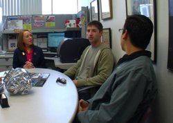 Patricia Reily, Troops to Engineers SERVICE director, talks with students Charles Lewis Belt III and Jacob Pepper in her office at San Diego State University.