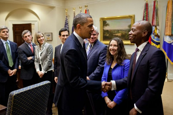 President Barack Obama greets participants In the Roosevelt Room of the White House prior to signing the Jumpstart Our Business Startups (JOBS) Act, April 5, 2012.